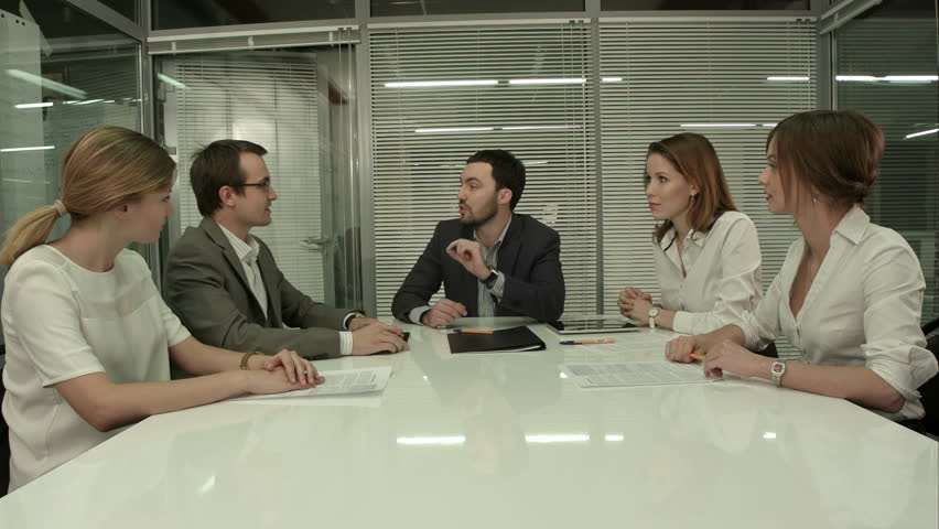 Closeup of group of business people applauding at a meeting | Shutterstock HD Video #10310684