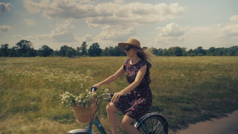 Woman In Hat.Girl Riding On Bicycle.Woman On Bicycle.Woman Bike Riding.Happy Beautiful Girl With Bike.Lady Moving On Bicycle.Attractive Lady Cycling.Woman With Blonde Hair Cycling.Beautiful Girl Hat.