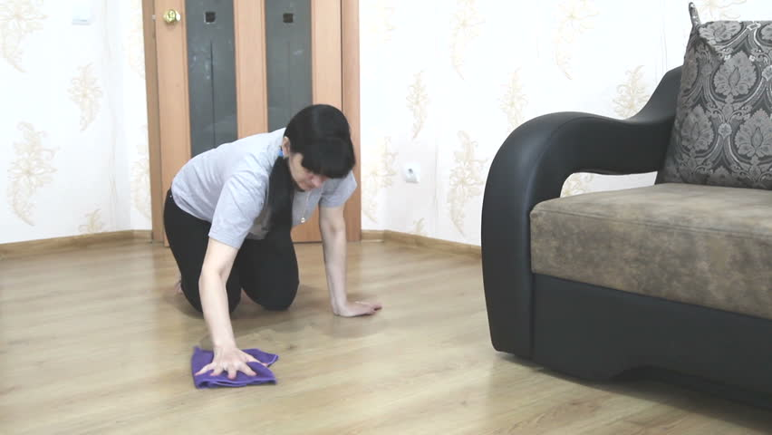 Young woman cleaning the floor with a cloth | Shutterstock HD Video #10310909