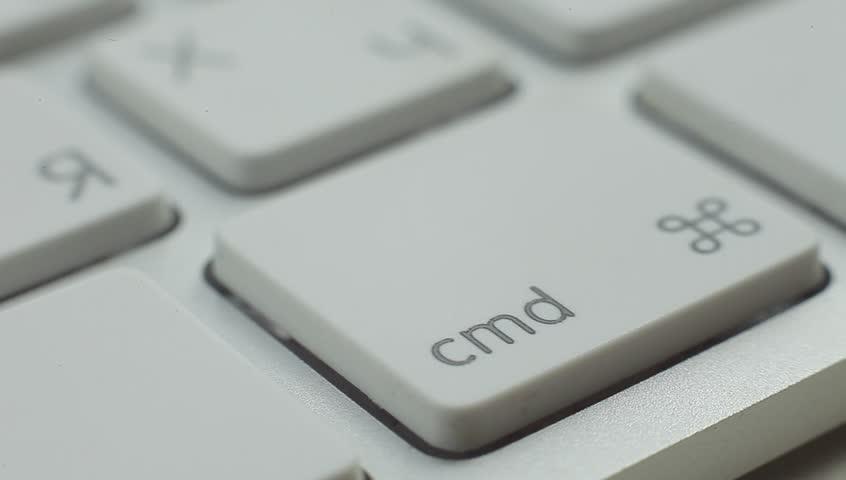 Finger Push Command (Cmd) Key Button of the Keyboard. Close up slow panorama. Macro shot. #10310969