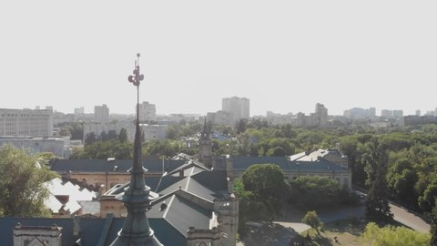 Aerial of a wonderful historic building with a narrow spire and a weathercock in Kyiv.