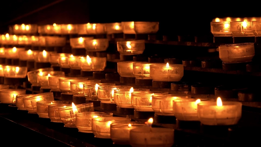 Lighting candle in church as a memory  | Shutterstock HD Video #1031192909