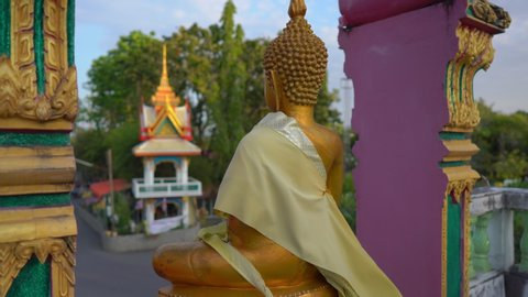 Steadicam shot of small Buddha statues in the Wat Srisoonthorn temple on Phuket island, Thailand. Travel to Thailand concept
