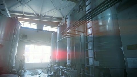 Stainless steel juice factory equipment, large reservoirs or tanks and pipes in modern plat, toned with light effect. Industrial background.