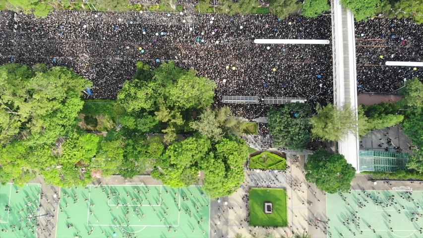 Hong Kong -June 16 2019: 2 million protesters stand out to oppose a controversial extradition bill which may include china. since June 9, hong kong people keep protest to against the extradition law. | Shutterstock HD Video #1031505989