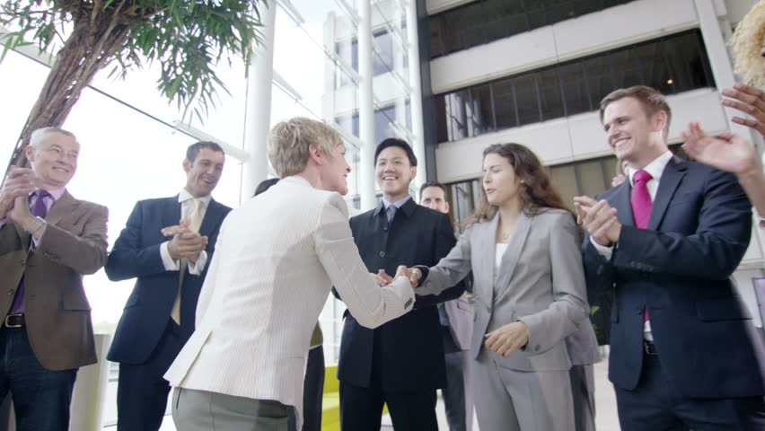 4k Confident diverse business team applauding their success and shaking hands with the boss   Shutterstock HD Video #10316909