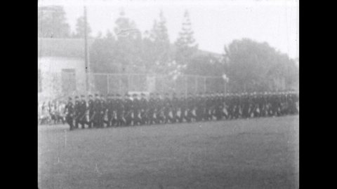 1960s: Recruit officers march through training field during graduation.