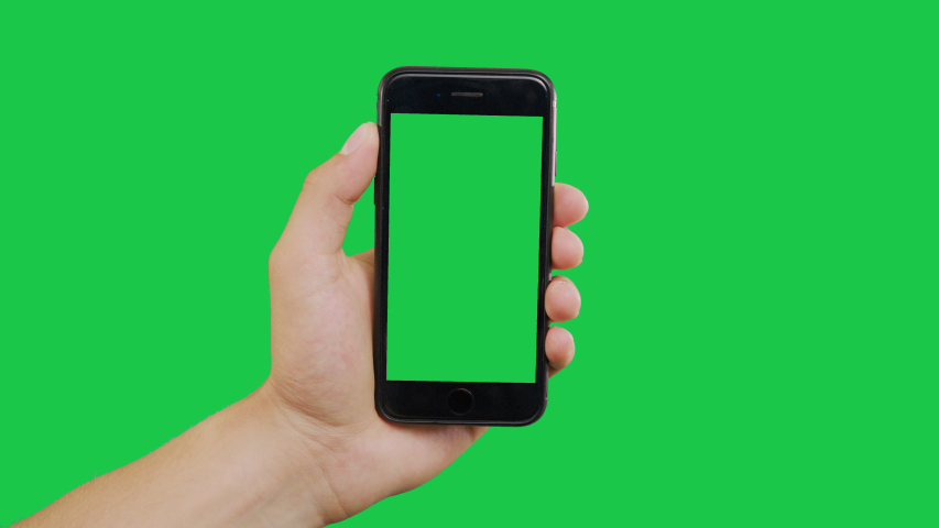 New York, USA - June 20, 2019: Finger Swipes Center Left Smartphone Green Screen. Pointing Finger Clicking On Phone Screen with Green Background. Use in any project that depicts finger, gesture | Shutterstock HD Video #1031905139