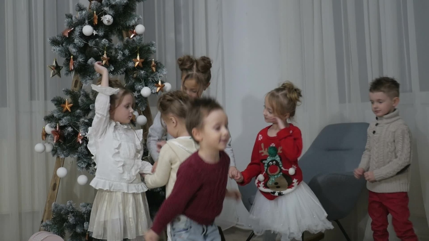 New Year's party for children, charming children's New Year's day happy emotions with friends | Shutterstock HD Video #1031969009