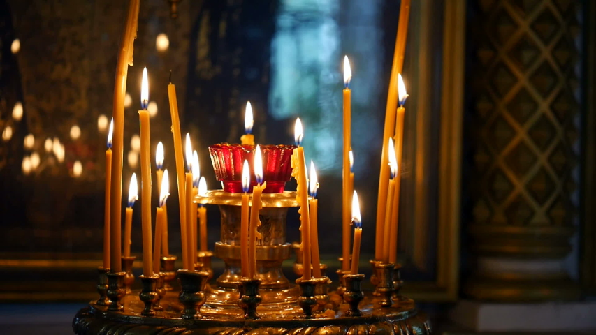 Burning candles in an Orthodox Church. Soft candlelight.   Shutterstock HD Video #1032022949
