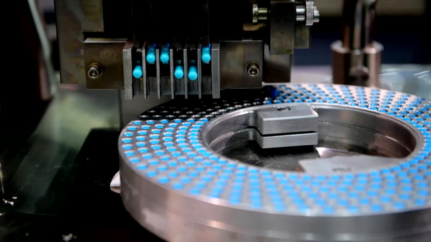 Blue capsule medicine pill production line, Industrial pharmaceutical concept. | Shutterstock HD Video #1032109319