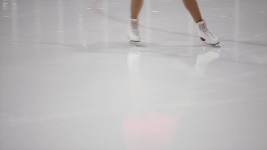 Figure skating, ice skating training. Feet skater on the ice, close-up, | Shutterstock HD Video #1032122519