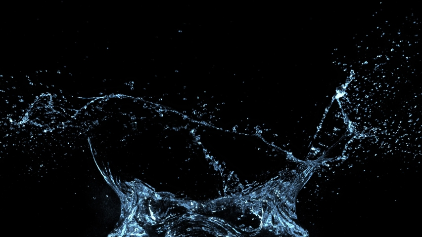 Super Slow Motion Shot of Water Splash at 1000fps Isolated on Black Background. #1032435479