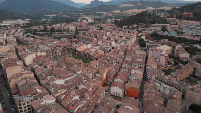 Aerial view of Estella, Spanish town along Camino de Santiago or Way of St James. Urban landscape with buildings and old cathedral in Navarre region, Spain seen from drone flying in sky | Shutterstock HD Video #1032445529