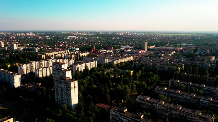 4K, Drone, Slowing shot of the urban skyline on a great summer day with green parks and blue skyline. Kyiv Oblast, Ukraine. | Shutterstock HD Video #1032503339