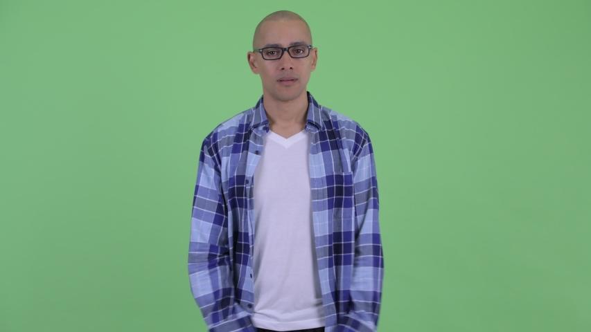 Sad bald hipster man giving thumbs down | Shutterstock HD Video #1032506369