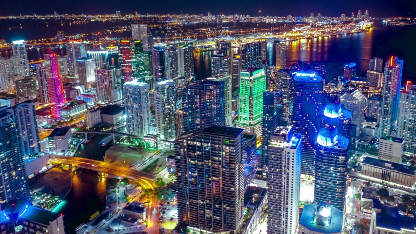 Top down aerial view of busy streets in downtown Miami, Miami City with bright night lighting. Best Miami Aerial shot. Wide shot on 4K camera. Miami downtown hyperlapse.