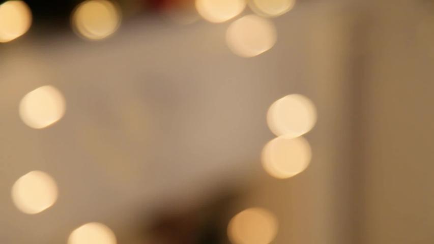 Christmas garland in defocus. footage | Shutterstock HD Video #1032550109
