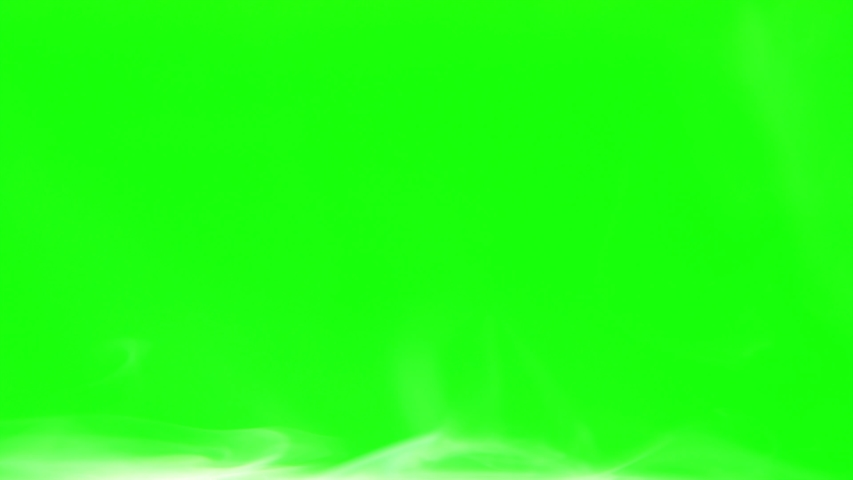 White smoke moves from left to right on the bottom of the frame green screen | Shutterstock HD Video #1032873449