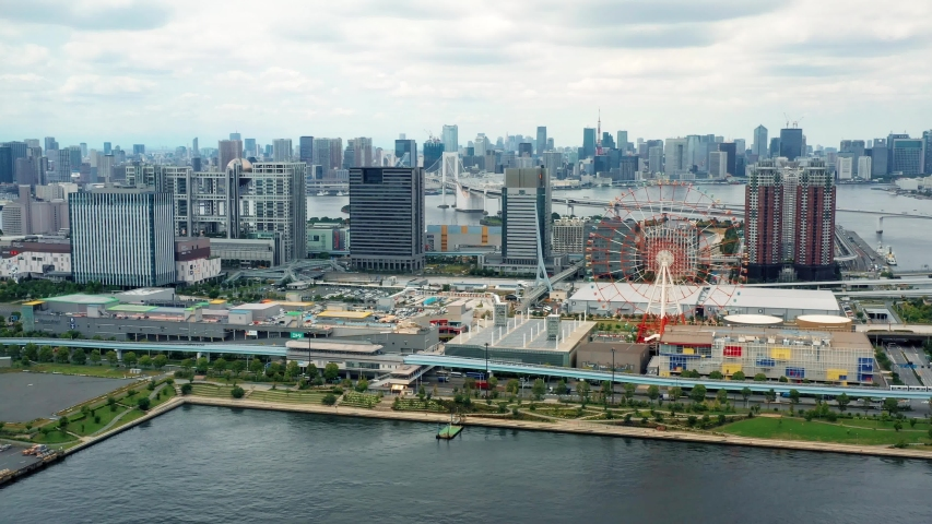 Panorama of Tokyo city with ferris wheel on bay in aerial view, Japan | Shutterstock HD Video #1033019639