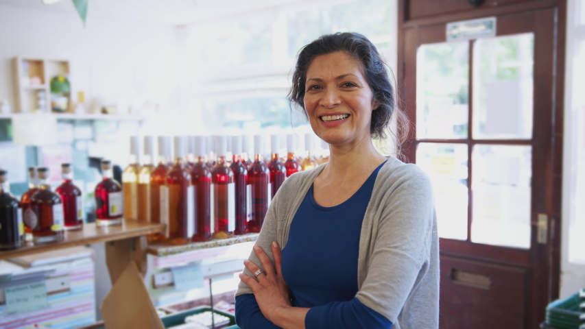 Portrait Of Mature Woman Running Organic Farm Shop | Shutterstock HD Video #1033022639