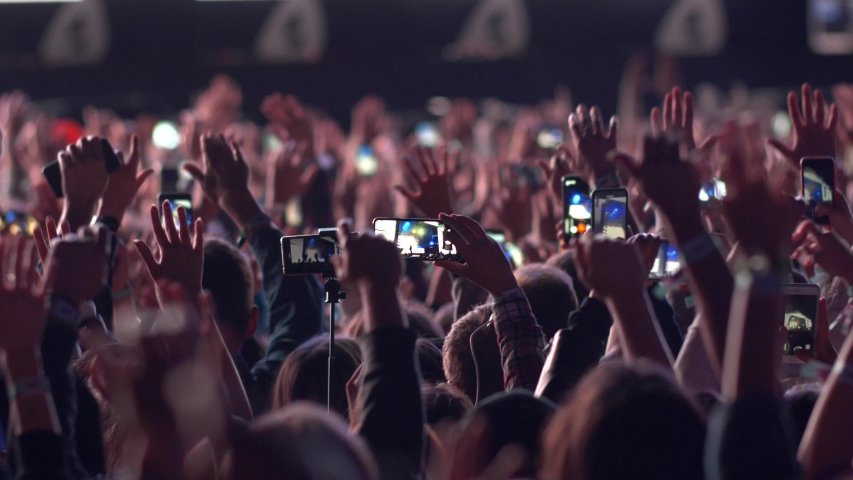 Concert fans. Audience with raised hands at music festival dancing during musical group performance. UHD, Slow motion. | Shutterstock HD Video #1033105679