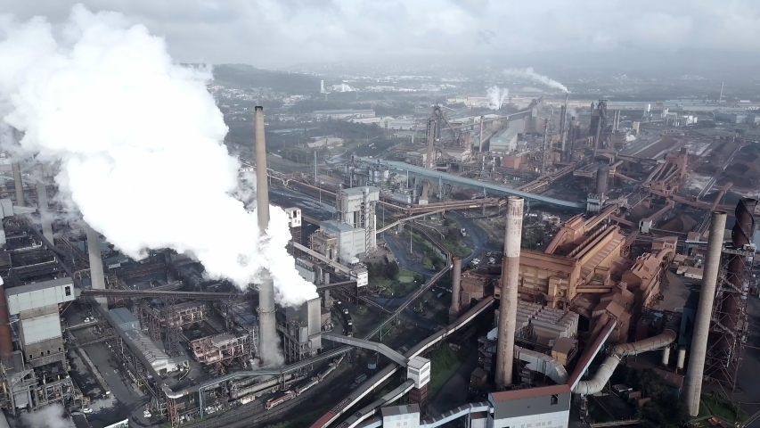Aerial Left: Industrial Buildings And Steam Coming Out Of Pipes, Wollongong, Australia #1033304639