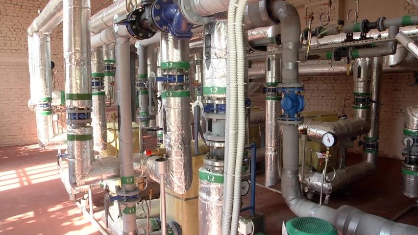 Modern boiler room equipment- high power boiler burner. Boiler room. Water heating. Power supply. Water supply.  | Shutterstock HD Video #1033387199