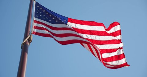 American Flag Slow Waving with visible wrinkles.Close up of UNITED STATES flag. USA,