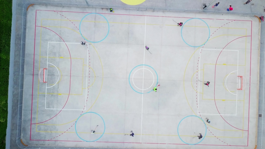 Children playing hockey, aerial video. hockey sport young boys players outdoors. Drone flying over hockey players kids in the summer | Shutterstock HD Video #1033447649