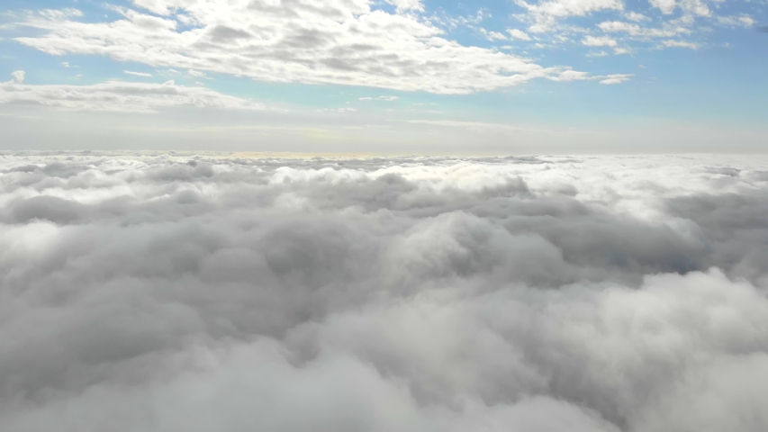 Flying in the clouds flying in the clouds. The clouds are moving on camera. Flying through the cloud | Shutterstock HD Video #1033475879
