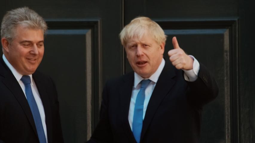LONDON, circa 2019 - British Prime Minister Boris Johnson salutes the crowds in London, England, UK after becoming British Prime Minister