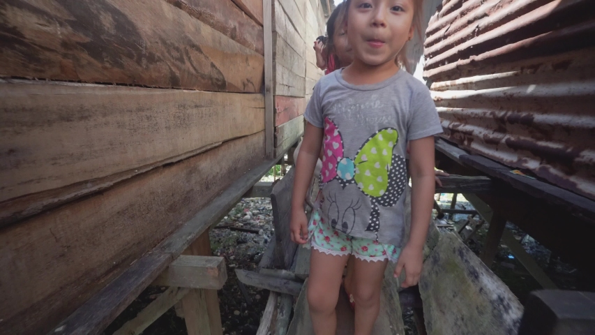 Iquitos, Peru. Circa 2019. Pueblo in coast amazon river people lives wood houses floating. Childrens playing in the water