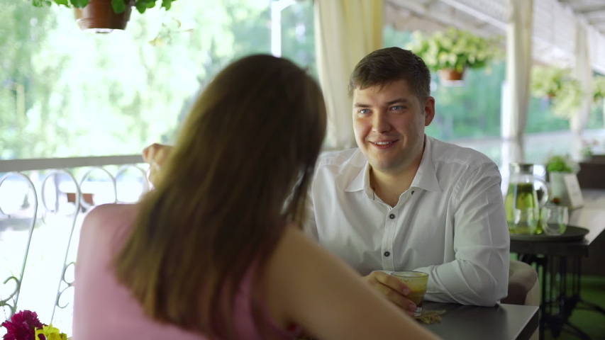 Young Couple Having Coffee Together. Man and Woman Talking on the Summer Terrace. Slow Motion. Love, Romance, Dating | Shutterstock HD Video #1033823279