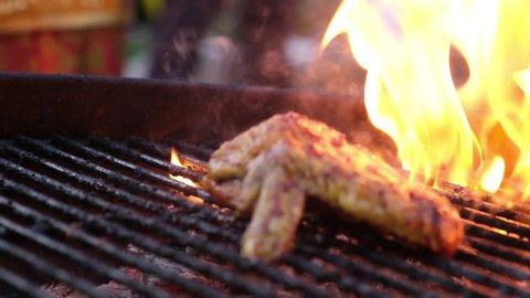 Grilling Ayam Bakar traditional Indonesian food