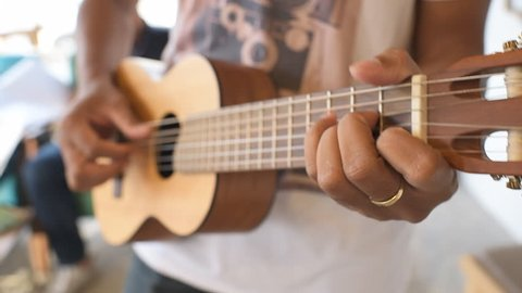 playing ukulele selective soft focus
