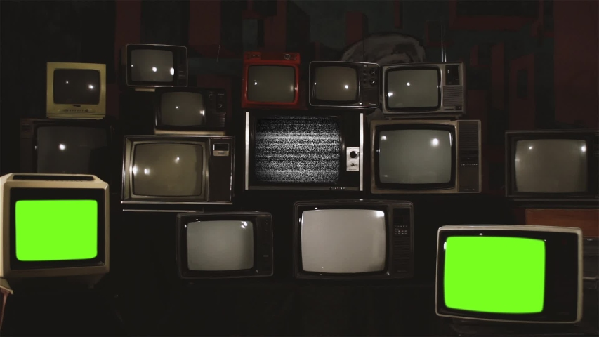 """Three Retro Televisions Turning On Green Screen. White Contrast Tone. You can replace green screen with the footage or picture you want with """"Keying"""" effect in AE (check out tutorials on Internet). 
