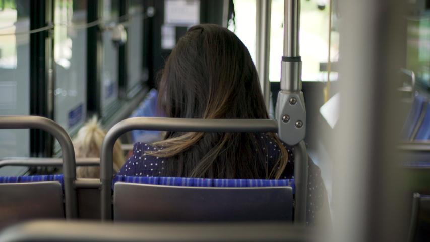 Woman rides city bus alone | Shutterstock HD Video #1034258729