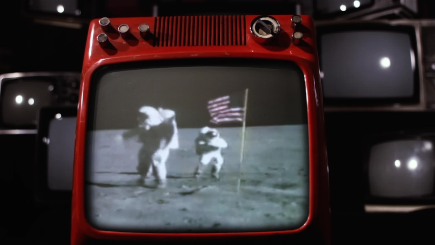 Astronauts salute the Usa flag during the Apollo 16 mission in 1972, On a Retro TV from the 70s.  Some Elements of this image furnished by NASA.  | Shutterstock HD Video #1034344019