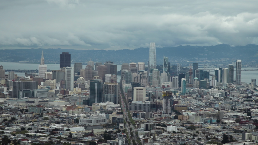 This sweeping cinematic, moody view of downtown San Francisco in 2019 on a cloudy day is an amazing establishing setting clip.  Shot in stunning 4K UHD resolution. | Shutterstock HD Video #1034396039