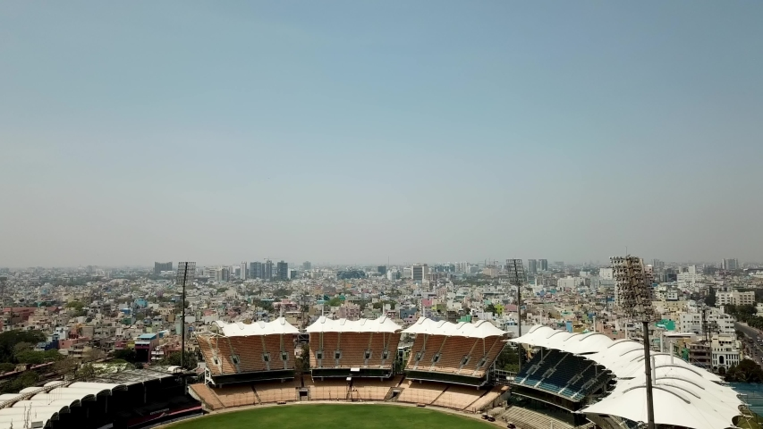 Chepauk, Chennai / India - March 2019: Aerial view East from Marina Beach sweeping over Chennai, India with a view of M. A. Chidambaram Stadium | Shutterstock HD Video #1034406929