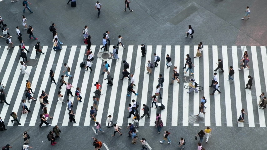Shibuya, Tokyo, Japan - Aerial view of pedestrians walk at Shibuya Crossing. The scramble crosswalk is one of the largest in the world. #1034411039