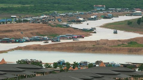 Busy River Waterway with Boats and houses