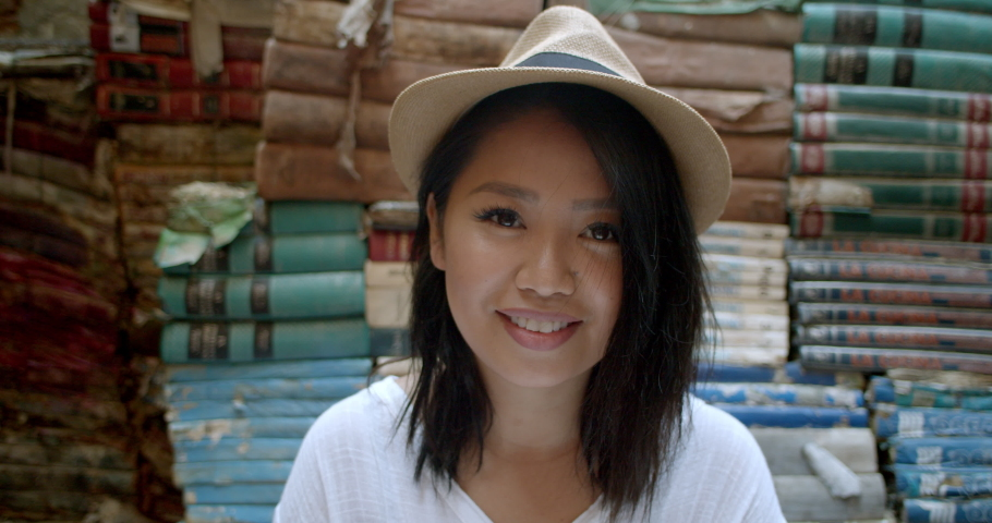 Portrait of young attractive woman in fedora travelling abroad in Venice Italy | Shutterstock HD Video #1034463989