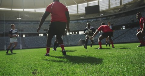 Front view of diverse rugby players playing rugby match in stadium. They are tackling each other 4k
