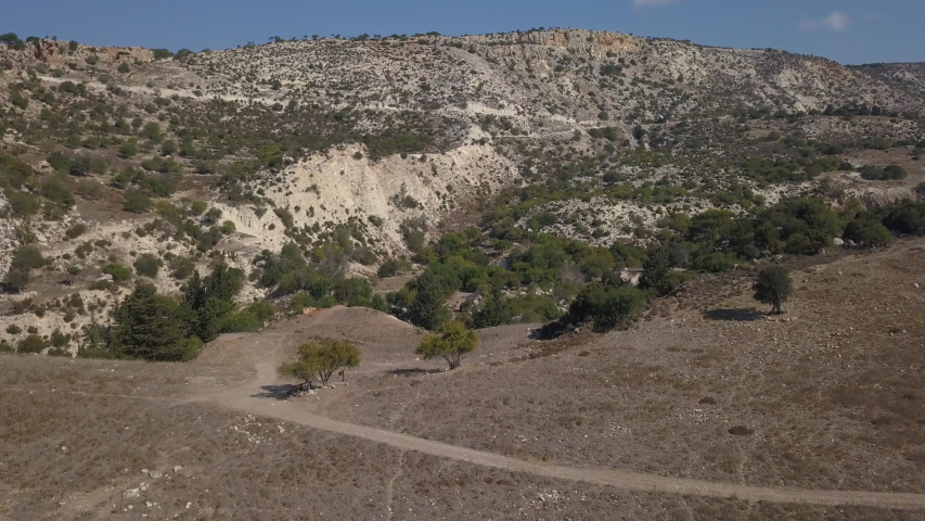 Aerial of Cyprus mountains Hill of dry land. Arid region   Shutterstock HD Video #1034812109