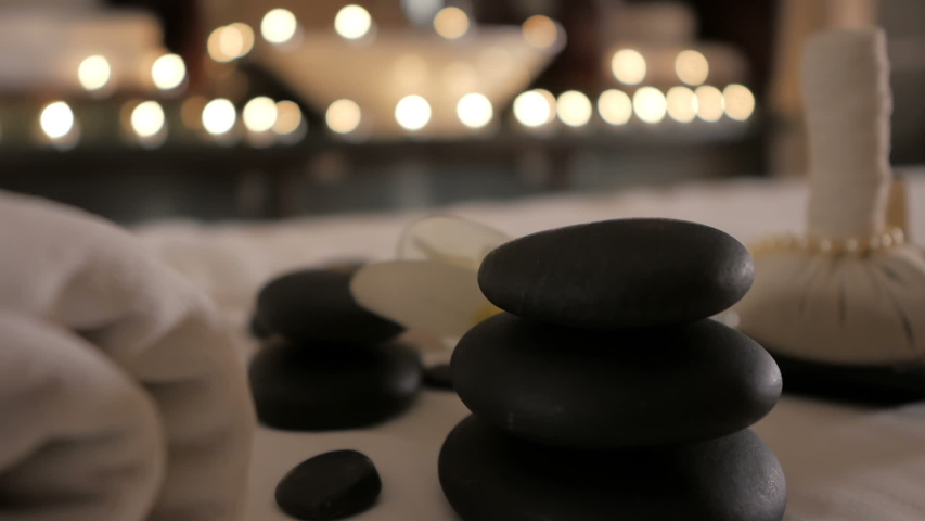 Beautiful spa composition on massage table in wellness center | Shutterstock HD Video #1034870489