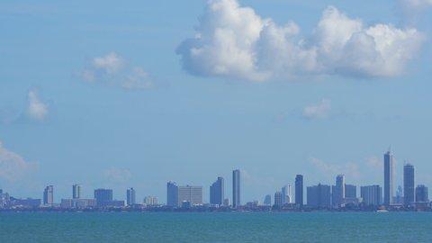 Wide establishing shot of Pattaya City skyline and Pattaya Bay Thailand.