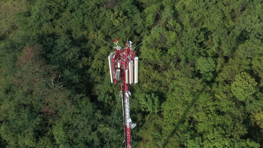 Radio and TV communication mast from above 4K drone footage   Shutterstock HD Video #1034997779