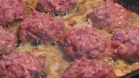 Roast meatballs on a frying pan